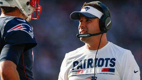 Sep 24, 2017; Foxborough, MA, USA;  New England Patriots offensive coordinator Josh McDaniels talks with quarterback Tom Brady (12) on the side line during the second half against the Houston Texans at Gillette Stadium. Mandatory Credit: Greg M. Cooper-USA TODAY Sports