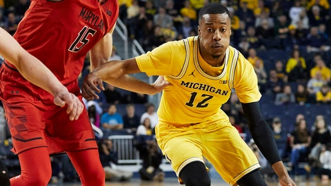 Jan 15, 2018; Ann Arbor, MI, USA; Michigan Wolverines guard Muhammad-Ali Abdur-Rahkman (12) dribbles the ball around Maryland Terrapins center Michal Cekovsky (15) in the first half at Crisler Center. Mandatory Credit: Rick Osentoski-USA TODAY Sports