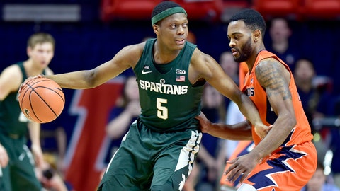 Michigan State guard Cassius Winston (5) looks for room to pass against the defense of Illinois guard Mark Alstork (24) during the first half of an NCAA college basketball game Monday, Jan. 22, 2018, in Champaign, Ill. (AP Photo/Stephen Haas)