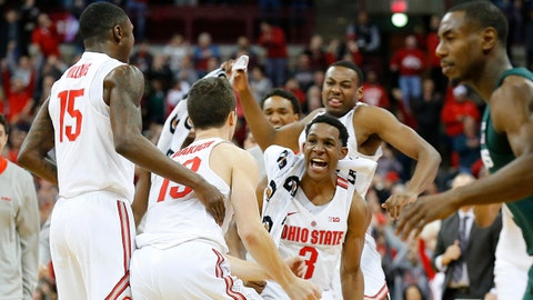 Jan 7, 2018; Columbus, OH, USA; Ohio State Buckeyes guard C.J. Jackson (3) celebrates with guard Andrew Dakich (13) after he hits a three pointer at the buzzer against the Michigan State Spartans at Value City Arena. Mandatory Credit: Joe Maiorana-USA TODAY Sports