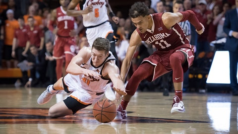 Jan 20, 2018; Stillwater, OK, USA; Oklahoma State Cowboys forward Mitchell Solomon (41) and Oklahoma Sooners guard Trae Young (11) fight for a loose ball during the second half at Gallagher-Iba Arena. Mandatory Credit: Rob Ferguson-USA TODAY Sports