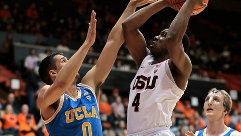 Oregon State's Alfred Hollins (4) shoots over UCLA'a Alex Olesinski (0) during the first half of an NCAA college basketball game in Corvallis, Ore., Thursday, Jan. 18,, 2018. (AP Photo/Timothy J. Gonzalez)