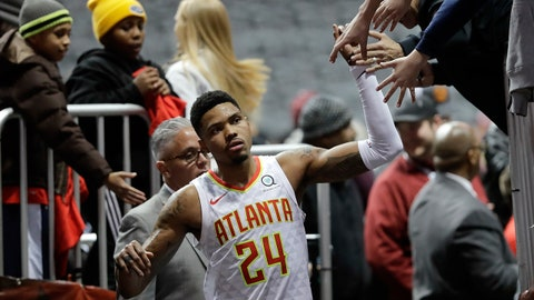 Atlanta Hawks guard Kent Bazemore (24) celebrates with the fans as he leaves the court after defeating New Orleans Pelicans 94-93 during an NBA basketball game Wednesday, Jan. 17, 2018, in Atlanta. Bazemore hit the game-winning shot in the final seconds of the game. (AP Photo/John Bazemore)