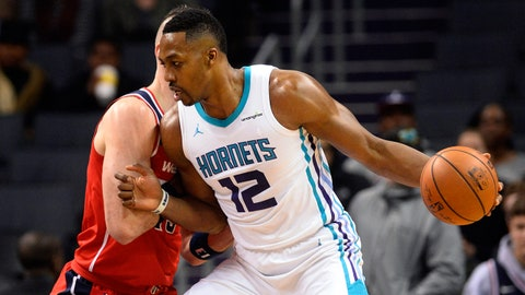 Jan 17, 2018; Charlotte, NC, USA; Charlotte Hornets forward center Dwight Howard (12) drives to the basket as eh is defended by Washington Wizards center Marcin Gortat (13) during the first half at the Spectrum Center. Mandatory Credit: Sam Sharpe-USA TODAY Sports
