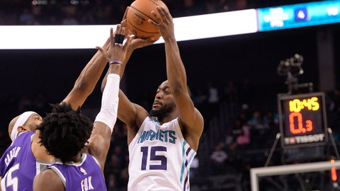 Jan 22, 2018; Charlotte, NC, USA; Charlotte Hornets guard Kemba Walker (15) shoots as he is defended by Sacramento Kings guard De'Aaron Fox (5) and guard forward Vince Carter (15) during the second half at the Spectrum Center. The Hornets won 112-107. Mandatory Credit: Sam Sharpe-USA TODAY Sports