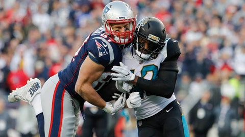 Jan 21, 2018; Foxborough, MA, USA; New England Patriots tight end Rob Gronkowski (87) is hit by Jacksonville Jaguars strong safety Barry Church (42) during the second quarter in the AFC Championship Game at Gillette Stadium. Mandatory Credit: David Butler II-USA TODAY Sports