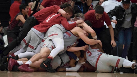 Jan 7, 2018; Stanford, CA, USA; Stanford Cardinal guard Daejon Davis (1) is mobbed by his teammates after shooting and making the winning three point shot against the USC Trojans at Maples Pavilion. Mandatory Credit: Neville E. Guard-USA TODAY Sports