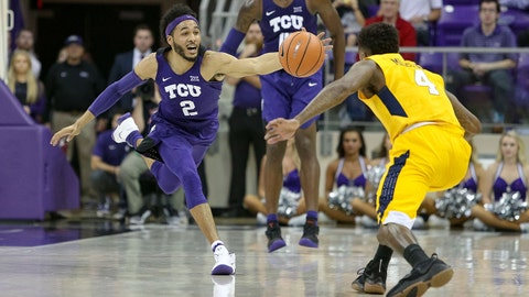 Jan 22, 2018; Fort Worth, TX, USA; TCU Horned Frogs guard Shawn Olden (2) stretches for a loose ball against West Virginia Mountaineers guard Daxter Miles Jr. (4) during the second half at Ed and Rae Schollmaier Arena. Mandatory Credit: Andrew Dieb-USA TODAY Sports