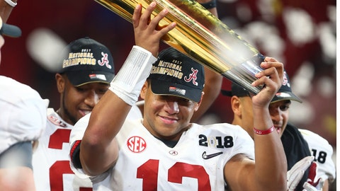 Jan 8, 2018; Atlanta, GA, USA; Alabama Crimson Tide quarterback Tua Tagovailoa (13) celebrates with the trophy after the 2018 CFP national championship college football game against the Georgia Bulldogs at Mercedes-Benz Stadium. Mandatory Credit: Mark J. Rebilas-USA TODAY Sports