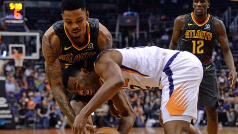 Jan 2, 2018; Phoenix, AZ, USA; Atlanta Hawks guard Kent Bazemore (24) and Phoenix Suns guard Phoenix Suns forward TJ Warren (12) go after a loose ball during the first half at Talking Stick Resort Arena. Mandatory Credit: Joe Camporeale-USA TODAY Sports