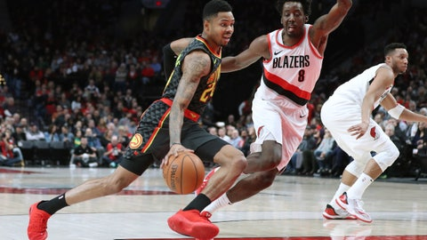 Jan 5, 2018; Portland, OR, USA;  Atlanta Hawks guard Kent Bazemore (24) dribbles around Portland Trail Blazers forward Al-Farouq Aminu (8) in the first half at Moda Center. Mandatory Credit: Jaime Valdez-USA TODAY Sports