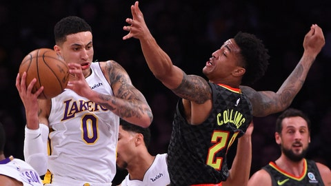 Jan 7, 2018; Los Angeles, CA, USA; Los Angeles Lakers forward Kyle Kuzma (0) holds on to a rebound in front of Atlanta Hawks forward John Collins (20) at Staples Center. Mandatory Credit: Jayne Kamin-Oncea-USA TODAY Sports
