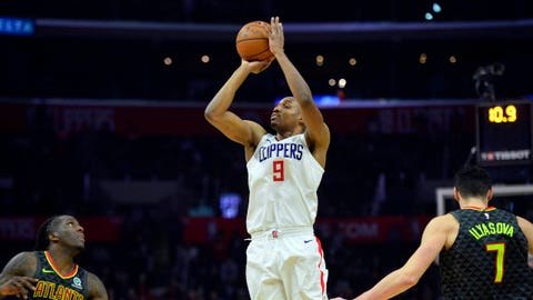 January 8, 2018; Los Angeles, CA, USA; Los Angeles Clippers guard C.J. Williams (9) scores a three point basket against the Atlanta Hawks during the second half at Staples Center. Mandatory Credit: Gary A. Vasquez-USA TODAY Sports
