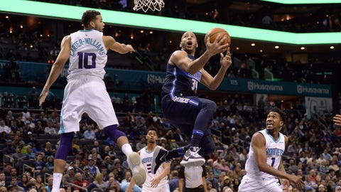 Jan 10, 2018; Charlotte, NC, USA; Dallas Mavericks guard Devin Harris (34) drives to the basket as he is defended by Charlotte Hornets guard Michael Carter-Williams (10) during the first half at the Spectrum Center. Mandatory Credit: Sam Sharpe-USA TODAY Sports