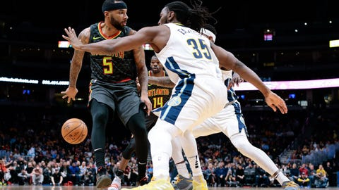 Jan 10, 2018; Denver, CO, USA; Atlanta Hawks guard Malcolm Delaney (5) passes the ball to center Dewayne Dedmon (14) defended by Denver Nuggets forward Kenneth Faried (35) in the first quarter at the Pepsi Center. Mandatory Credit: Isaiah J. Downing-USA TODAY Sports