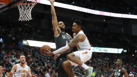 Jan 12, 2018; Atlanta, GA, USA; Atlanta Hawks guard Kent Bazemore (24) attempts a pass around Brooklyn Nets center Jahlil Okafor (4) during the second quarter at Philips Arena. Mandatory Credit: Jason Getz-USA TODAY Sports