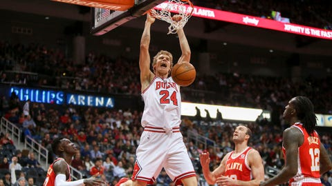 Jan 20, 2018; Atlanta, GA, USA; Chicago Bulls forward Lauri Markkanen (24) dunks against the Atlanta Hawks in the first quarter at Philips Arena. Mandatory Credit: Brett Davis-USA TODAY Sports