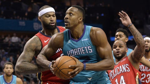 Jan 24, 2018; Charlotte, NC, USA; Charlotte Hornets forward center Dwight Howard (12) drives to the basket as he is defended by New Orleans Pelicans forward DeMarcus Cousins (0) during the second half at Spectrum Center. The Pelicans won 101-96. Mandatory Credit: Sam Sharpe-USA TODAY Sports
