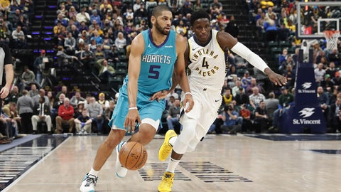 Jan 29, 2018; Indianapolis, IN, USA; Charlotte Hornets forward Nicolas Batum (5) drives to the basket against Indiana Pacers guard Victor Oladipo (4) during the first quarter at Bankers Life Fieldhouse. Mandatory Credit: Brian Spurlock-USA TODAY Sports