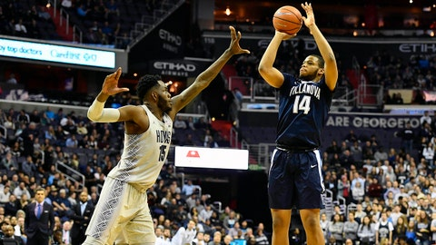 Jan 17, 2018; Washington, DC, USA; Villanova Wildcats forward Omari Spellman (14) shoots over Georgetown Hoyas center Jessie Govan (15) during the first half at Capital One Arena. Mandatory Credit: Brad Mills-USA TODAY Sports