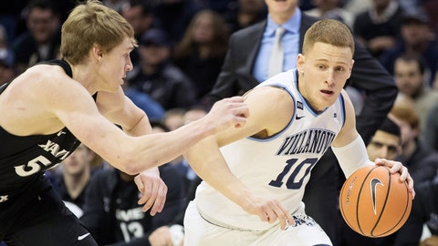 Jan 10, 2018; Philadelphia, PA, USA; Villanova Wildcats guard Donte DiVincenzo (10) dribbles against Xavier Musketeers guard J.P. Macura (55) during the first half at Wells Fargo Center. Mandatory Credit: Bill Streicher-USA TODAY Sports