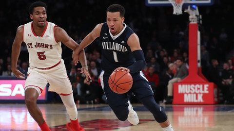 Jan 13, 2018; Queens, NY, USA; Villanova Wildcats guard Jalen Brunson (1) drives past St. John's Red Storm guard Justin Simon (5) during the first half at Madison Square Garden. Mandatory Credit: Anthony Gruppuso-USA TODAY Sports