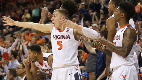 Jan 23, 2018; Charlottesville, VA, USA; Virginia Cavaliers guard Kyle Guy (5) celebrates with teammates on the bench against the Clemson Tigers in the second half at John Paul Jones Arena. The Cavaliers won 61-39. Mandatory Credit: Geoff Burke-USA TODAY Sports