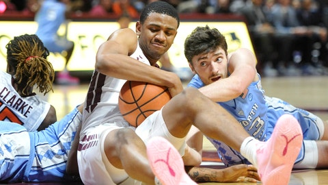 Jan 22, 2018; Blacksburg, VA, USA; Virginia Tech Hokies guard/forward Nickeil Alexander-Walker (4) fights for a loose ball against North Carolina Tar Heels guard Andrew Platek (3) in the first half at Cassell Coliseum. Mandatory Credit: Michael Shroyer-USA TODAY Sports