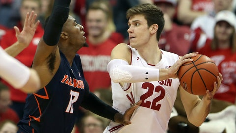 Jan 19, 2018; Madison, WI, USA; Wisconsin Badgers forward Ethan Happ (22) looks to pass as Illinois Fighting Illini forward Leron Black (12)  during the first half defends at the Kohl Center. Mandatory Credit: Mary Langenfeld-USA TODAY Sports