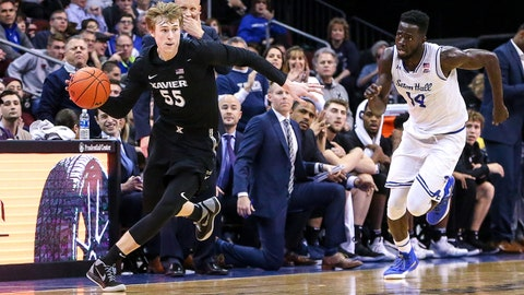 Jan 20, 2018; Newark, NJ, USA; Xavier Musketeers guard J.P. Macura (55) passes the ball in front of Seton Hall Pirates forward Ismael Sanogo (14) during the first half at Prudential Center. Mandatory Credit: Vincent Carchietta-USA TODAY Sports