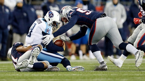 Jan 13, 2018; Foxborough, MA, USA; Tennessee Titans quarterback Marcus Mariota (8) is sacked by New England Patriots defensive tackle Deatrich Wise (91) and outside linebacker Kyle Van Noy (53) during the forth quarter of the AFC Divisional playoff game at Gillette Stadium. Mandatory Credit: Greg M. Cooper-USA TODAY Sports