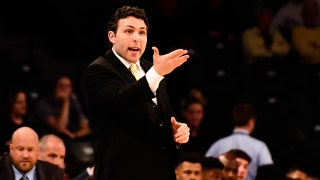 Josh Pastner putting signature on Georgia Tech program