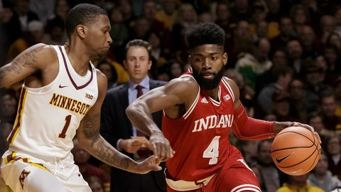 Jan 6, 2018; Minneapolis, MN, USA; Indiana Hoosiers guard Robert Johnson (4) dribbles in the first quarter against the Minnesota Gophers guard Dupree McBrayer (1) at Williams Arena. Mandatory Credit: Brad Rempel-USA TODAY Sports