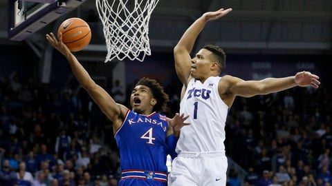 Jan 6, 2018; Fort Worth, TX, USA; Kansas Jayhawks guard Devonte' Graham (4) is fouled on a shot by TCU Horned Frogs guard Desmond Bane (1) at Ed and Rae Schollmaier Arena. Mandatory Credit: Tim Heitman-USA TODAY Sports