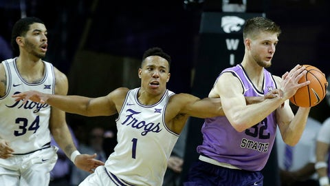 TCU's Desmond Bane (1) tries to steal the ball from Kansas State's Dean Wade (32) during the second half of an NCAA college basketball game Saturday, Jan. 20, 2018, in Manhattan, Kan. Kansas State won 73-68. (AP Photo/Charlie Riedel)
