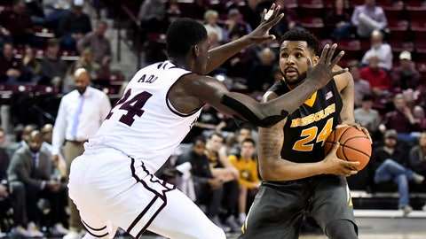 Jan 27, 2018; Starkville, MS, USA; Missouri Tigers forward Kevin Puryear (24) handles the ball as he is defended by Mississippi State Bulldogs forward Abdul Ado (24) during the first half at Humphrey Coliseum. Mandatory Credit: Matt Bush-USA TODAY Sports