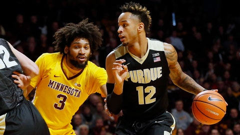 Purdue's Vincent Edwards, right, drives around Minnesota's Jordan Murphy during the first half of an NCAA college basketball game, Saturday, Jan. 13, 2018, in Minneapolis. (AP Photo/Jim Mone)