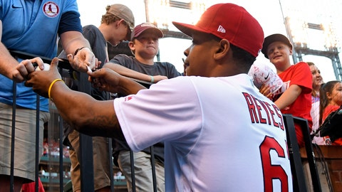 Jun 30, 2017; St. Louis, MO, USA; St. Louis Cardinals relief pitcher Alex Reyes (61) signs autographs prior to the start of a game against the Washington Nationals at Busch Stadium. Mandatory Credit: Jeff Curry-USA TODAY Sports