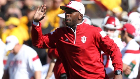 Oct 11, 2014; Iowa City, IA, USA; Indiana Hoosiers runnings back coach Deland McCullough signals in to his team during their game against the Iowa Hawkeyes at Kinnick Stadium. Iowa beat Indiana 45-29.  Mandatory Credit: Reese Strickland-USA TODAY Sports