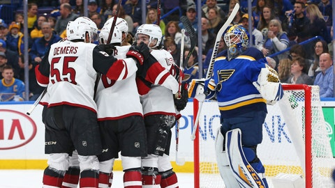 an 20, 2018; St. Louis, MO, USA; St. Louis Blues goaltender Carter Hutton (40) reacts as members of the Arizona Coyotes celebrate a goal by center Christian Dvorak (18) during the first period at Scottrade Center. Mandatory Credit: Billy Hurst-USA TODAY Sports