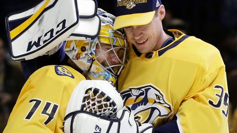 Nashville Predators goalie Juuse Saros (74), of Finland, gets a hug from fellow goalie Pekka Rinne (35), of Finland, after Saros stopped 43 shots to shut out the Vegas Golden Knights 1-0 in an NHL hockey game Tuesday, Jan. 16, 2018, in Nashville, Tenn. (AP Photo/Mark Humphrey)