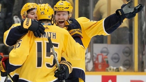 Nashville Predators defenseman Matt Irwin, right, celebrates with right wing Craig Smith (15) after Smith scored the winning goal against the Arizona Coyotes during the shootout in an NHL hockey game Thursday, Jan. 18, 2018, in Nashville, Tenn. The Predators won 3-2. (AP Photo/Mark Humphrey)