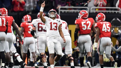 Jan 8, 2018; Atlanta, GA, USA; Alabama Crimson Tide quarterback Tua Tagovailoa (13) reacts after throwing a touchdown pass during the third quarter against the Georgia Bulldogs in the 2018 CFP national championship college football game at Mercedes-Benz Stadium. Mandatory Credit: John David Mercer-USA TODAY Sports