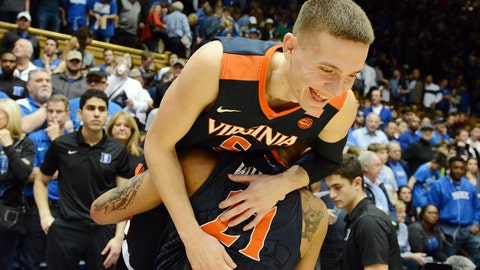 Jan 27, 2018; Durham, NC, USA; Virginia Cavaliers guard Kyle Guy (5) is carried off the court by forward Isaiah Wilkins (21) after a win against the Duke Blue Devils during the second half at Cameron Indoor Stadium. Virginia won 65-63. Mandatory Credit: Rob Kinnan-USA TODAY Sports