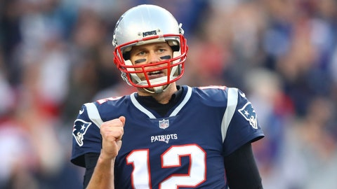 Jan 21, 2018; Foxborough, MA, USA; New England Patriots quarterback Tom Brady (12) celebrates after throwing a second quarter touchdown against the Jacksonville Jaguars during the AFC Championship at Gillette Stadium. Mandatory Credit: Mark J. Rebilas-USA TODAY Sports