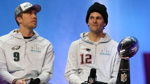 Jan 29, 2018; St. Paul, MN, USA; Philadelphia Eagles quarterback Nick Foles (9) and New England Patriots quarterback Tom Brady (12) do an interview on NFL Network during Super Bowl LII Opening Night at Xcel Energy Center. Mandatory Credit: Matthew Emmons-USA TODAY Sports