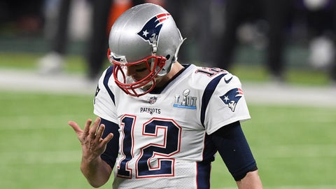 Feb 4, 2018; Minneapolis, MN, USA; New England Patriots quarterback Tom Brady (12) checks his hand after throwing the ball in the first quarter against the Philadelphia Eagles in Super Bowl LII at U.S. Bank Stadium. Mandatory Credit: John David Mercer-USA TODAY Sports
