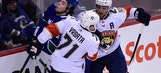 Panthers hold off Canucks for win on emotional night