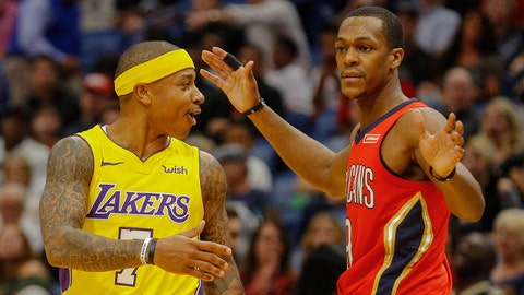 Feb 14, 2018; New Orleans, LA, USA; Los Angeles Lakers guard Isaiah Thomas (7) and New Orleans Pelicans guard Rajon Rondo (9) exchange words during the first quarter at the Smoothie King Center. Mandatory Credit: Derick E. Hingle-USA TODAY Sports