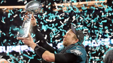 Feb 4, 2018; Minneapolis, MN, USA; Philadelphia Eagles quarterback Nick Foles (9) celebrates with the the Vince Lombardi Trophy after defeating the New England Patriots in Super Bowl LII at U.S. Bank Stadium. Mandatory Credit: Winslow Townson-USA TODAY Sports